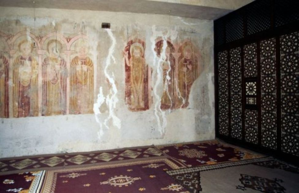 A view of the inside of the Monastery Of Saint Macarius The Great, featuring faded frescoes