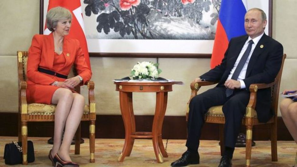 Theresa May y Vladimir Putin.