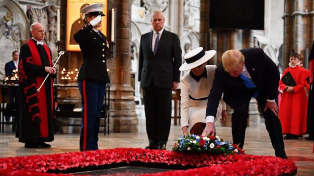 The US president and first lady laying a wreath at Westminster Abbey