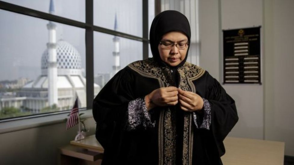 Nenney Shushaidah adjusts her robes