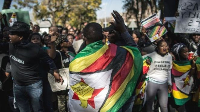 Zimbabwean 'ThisFlag' activists on July 14, 2016 march to the Zimbabwean embassy in Pretoria