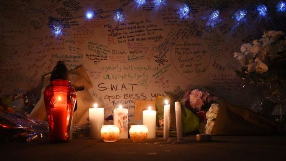 Candles and messages of condolence near where the fire broke out at Grenfell Tower