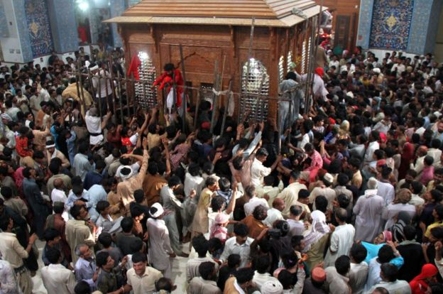 Pakistani devotees gather on 18 June, 2014 at the shrine of 13th century Muslim Sufi saint Lal Shahbaz Qalandar, in Sehwan