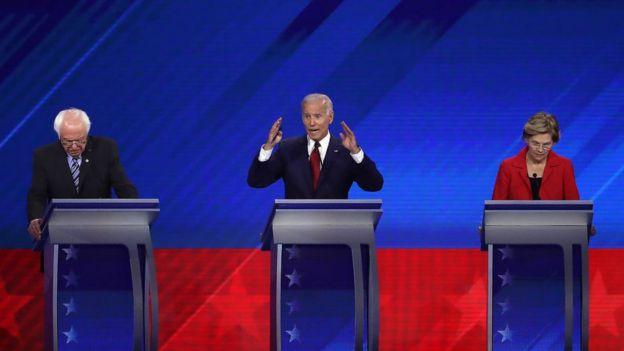 Mr Sanders, Mr Biden and Ms Warren on stage at the Houston debate in September