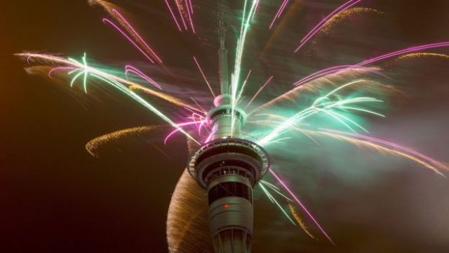 Firework display from the top of the Sky Tower to welcome the New Year on January 1, 2015 in Auckland, New Zealand.