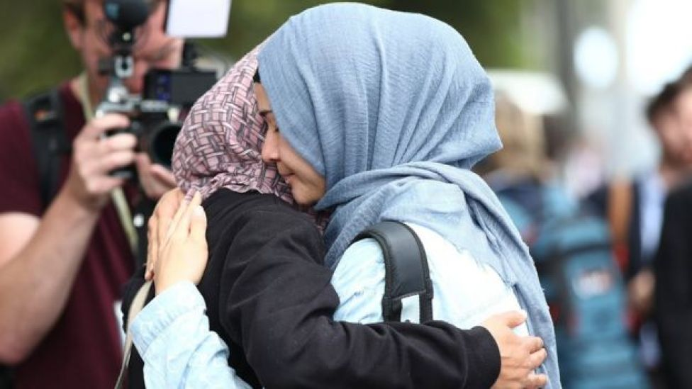 Friends and family of the victims gather at the support centre at the Hagley Community College