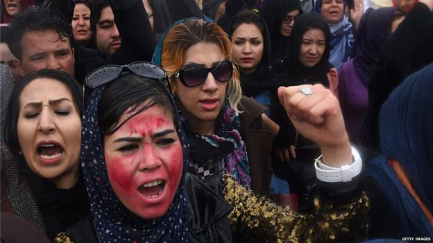 Afghan protesters shout slogans during a rally in front of the Supreme Court in Kabul on March 24