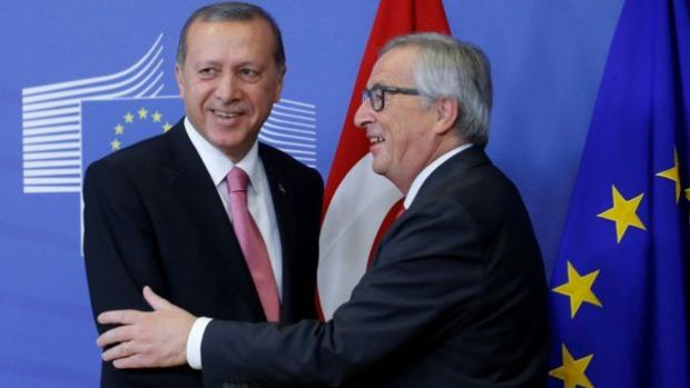 European Commission President Jean Claude Juncker (R) speaks to the media as he welcomes Turkish President Recep Tayyip Erdogan at the EU Commission in Brussels, Belgium, 5 October 2015