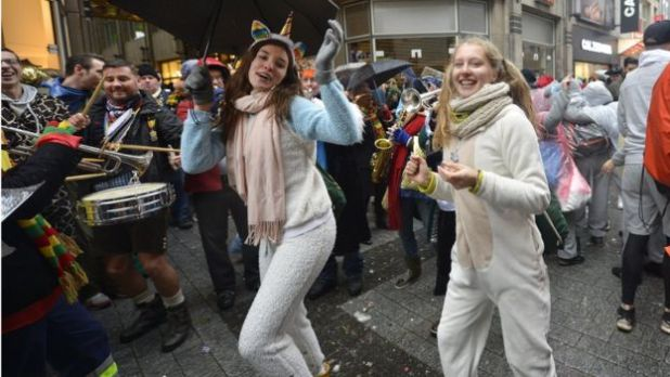 Two young women taking part in carnival celebrations
