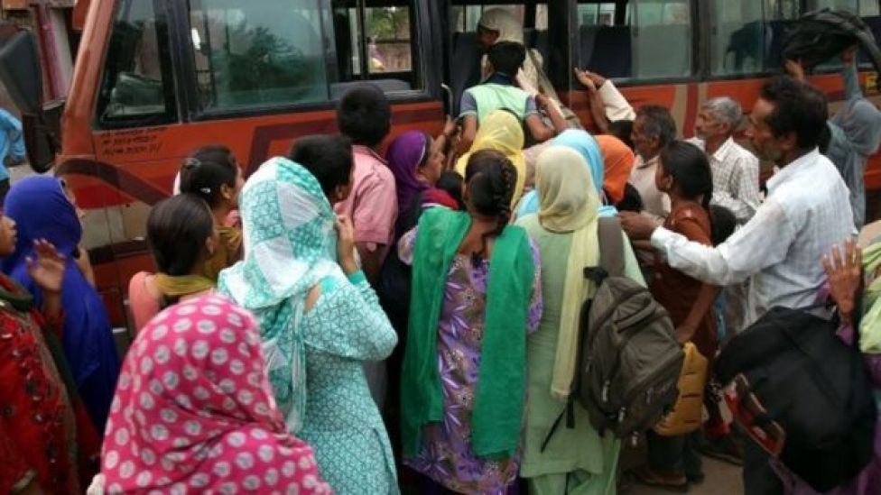Indian villagers board a bus provided by the government as families are evacuated from their homes a safer place after authorities ordered the evacuation of villages near the Pakistan border, at Chillyari village, about 60km from Jammu in Indian-administered Kashmir (30 September 2016)
