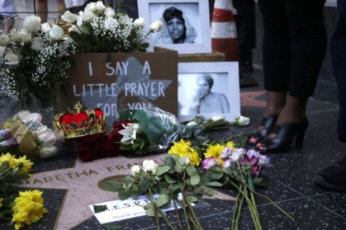 Flowers and tributes are placed on the Star for Aretha Franklin on the Hollywood Walk of Fame in Hollywood, California, August 16, 2018