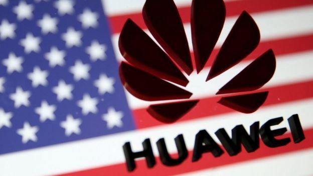 US flag and Huawei logo