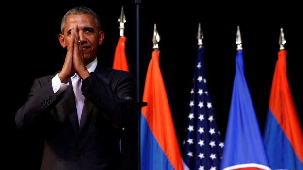 US President Barack Obama holds his hands together and bows at the end of his address at the Lao National Cultural Hall, on the sidelines of the ASEAN Summit, in Vientiane, Laos 6 September 2016.