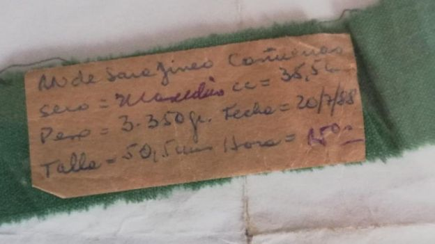 A baby bracelet for Sara Jineo's lost child, pictured in Temuco, Chile, showing the birth date and measurements