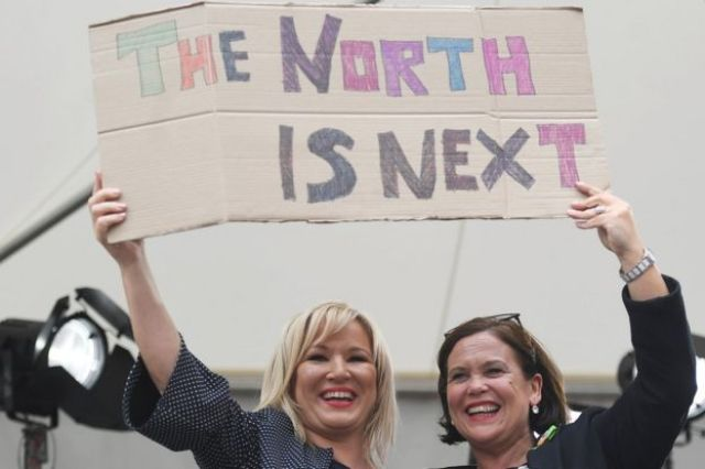 Sinn Féin's Michelle O Neill and Mary Lou McDonald hold placard saying 'The north is next'