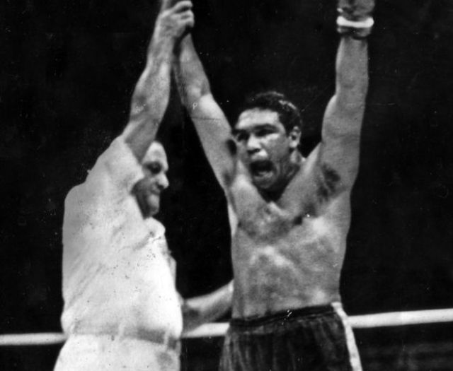 Wally Carr's arm is held up afer winning a bout