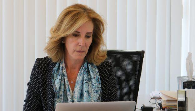 María Elena Morera working in her office