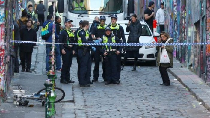 Police at the scene of Mr Dick's arrest in a central Melbourne laneway