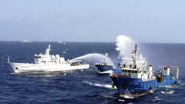 This photo taken on July 14, 2016 shows Chinese ships putting out a fire on a mock cargo vessel during an emergency drill in the South China Sea near Sansha, in south China's Hainan province.