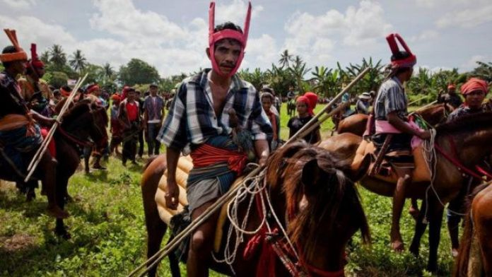 Men at the main cultural event in Sumba Pasola, getting ready to fight