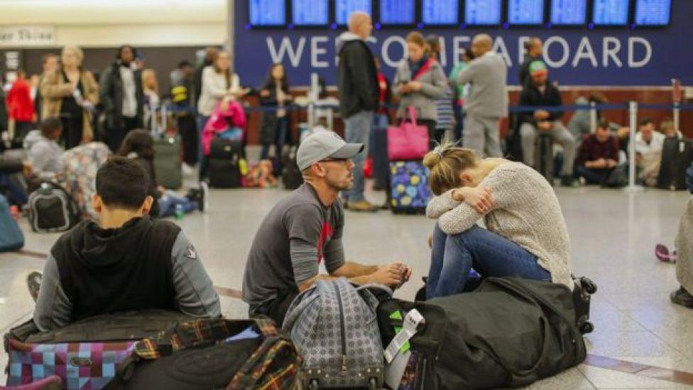 Viagantes no aeroporto de Atlanta, nos EUA