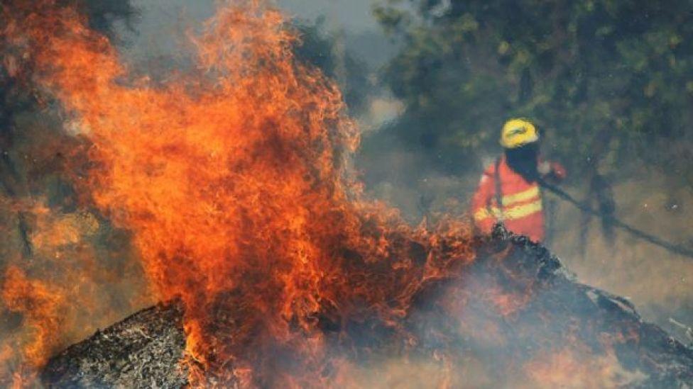 Flames and fireman