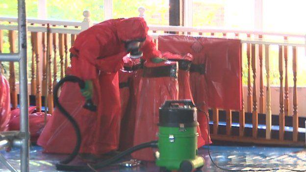 Man removing asbestos at school