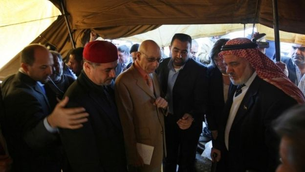 Gerald Kaufman (3rd L), the head of a European Parliament delegation, meets with residents of Jabalia