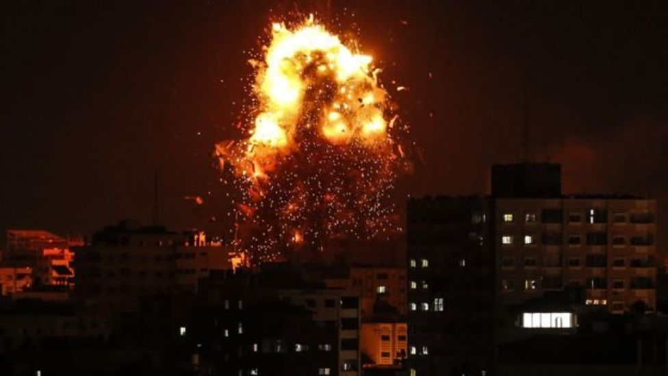 The building housing the Hamas-run television station Al-Aqsa in the Gaza Strip is hit during an Israeli air strike, 2 November 2018