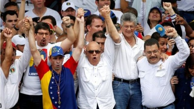 Venezuelan opposition leaders Henrique Capriles (L), Jesus Torrealba, secretary of Venezuela's coalition of opposition parties (MUD) and Henry Ramos Allup (2nd R), President of the National Assembly and deputy of the Venezuelan coalition of opposition parties (MUD), take part in a rally to demand a referendum to remove Venezuela's President Nicolas Maduro, in Caracas, Venezuela, September 1, 2016