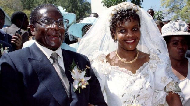President Robert Mugabe and new wife Grace leave the Kutama Catholic Church in Zimbabwe August 17, 1996 after exchanging their wedding vows.