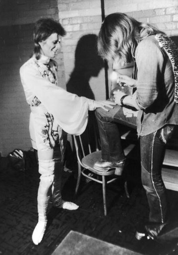 Make-up artist Pierre La Roche prepares English singer David Bowie for a performance as Aladdin Sane, 1973. Bowie is wearing a costume by Japanese designer Kansai Yamamoto.