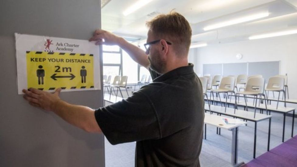 Ark Charter Academy in Portsmouth puts up social distancing signs