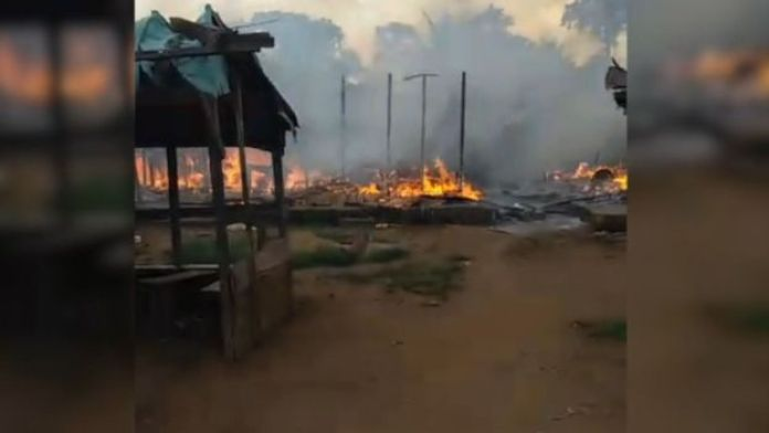 The village of Kuke Mbomo seen on fire