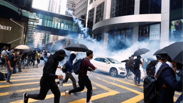 Protesters running from tear gas in central Hong Kong
