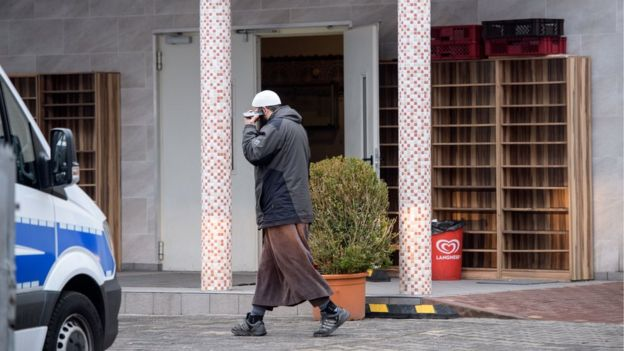 Man walks outside the Bilal mosque in Griesheim district of Frankfurt while police investigate inside on February 1