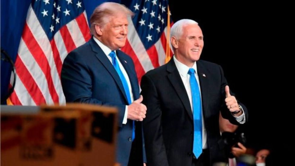 Mr Trump with Vice-President Mike Pence