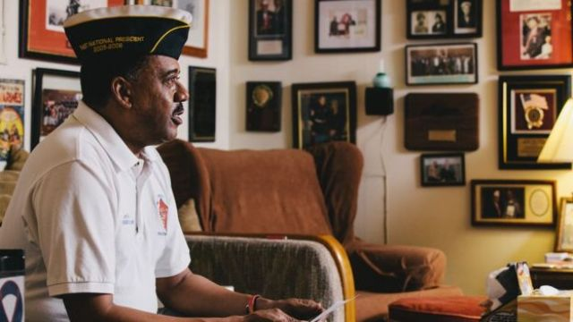 Joe Geeter at his Montford Point Marines office, images of military memorabilia on the walls