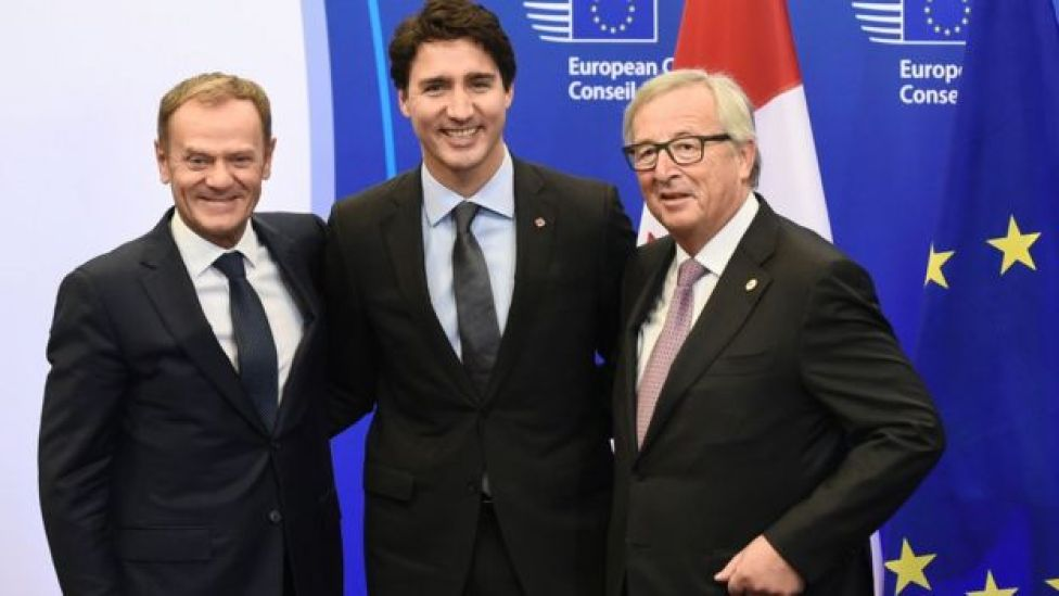 European Council President Donald Tusk, Canadian Prime Minister Justin Trudeau and European Commission President Jean-Claude Juncker
