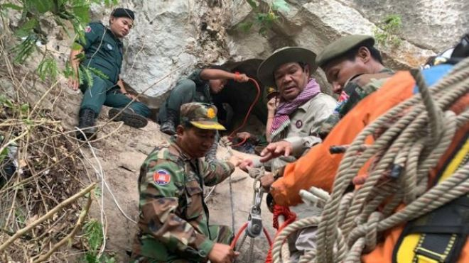 Rescuers at the cave entrance