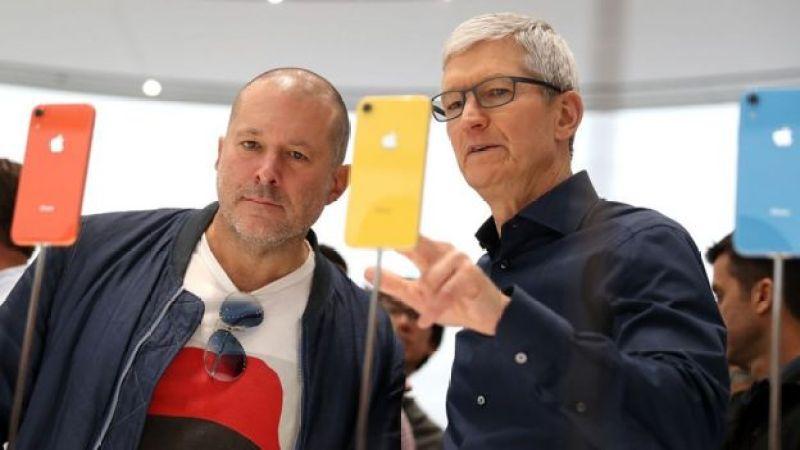 Tim Cook e vários iPhones
