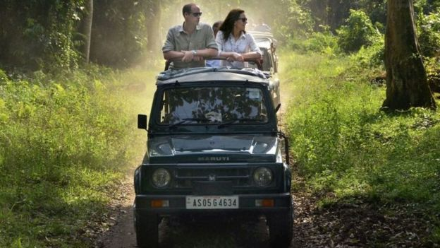 Britain's Prince William (left) and Kate Duchess of Cambridge take an open vehicle safari inside the Kaziranga National Park in India's north-eastern state of Assam