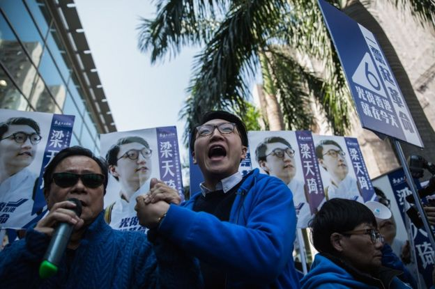 Hong Kong activist Edward Leung (C), 24, one of the leaders of