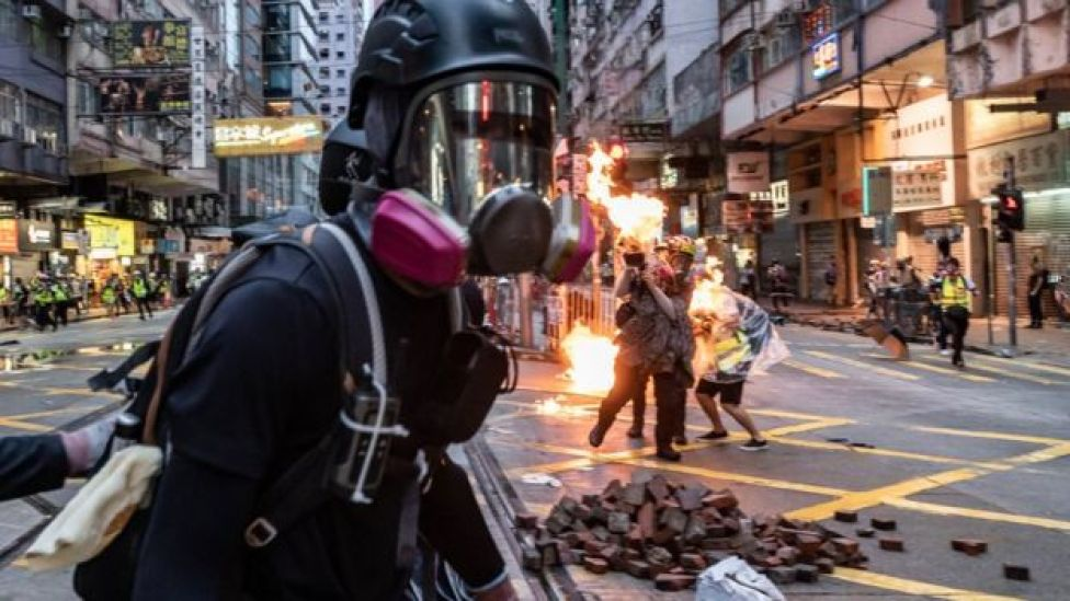 Members of media were hit by Molotov cocktail during a clash between protester and police at a demonstration in Wan Chai district on October 6, 2019 in Hong Kong, China.