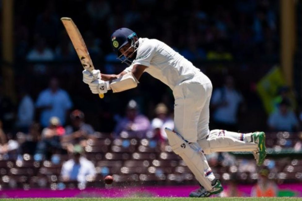 India batsman Cheteshwar Pujara hits a ball on the second day of the fourth and final cricket Test against Australia at the Sydney Cricket Ground on January 4, 2019.