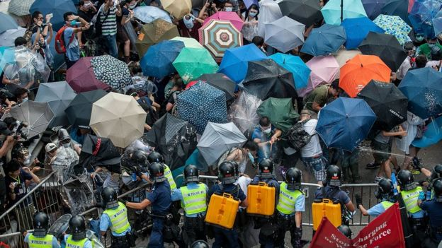 Protesters clash with riot police on September 28, 2014 in Hong Kong