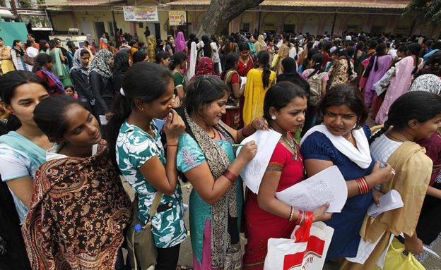 A crowd waits to get their names registered at Lal Bagh Employment Office on March 13, 2012 in Lucknow, India.