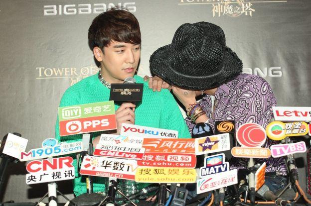 Seungri and G-Dragon of South Korean boy band Bigbang give a press conference in 2014