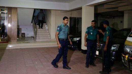 Bangladeshi police at Mr Mannan's building on 25 April 2016