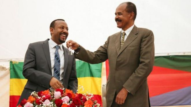 Eritrea's President Isaias Afwerki receives a key from Abiy Ahmed as the Eritrean Embassy in Addis Ababa is re-opened in 2018